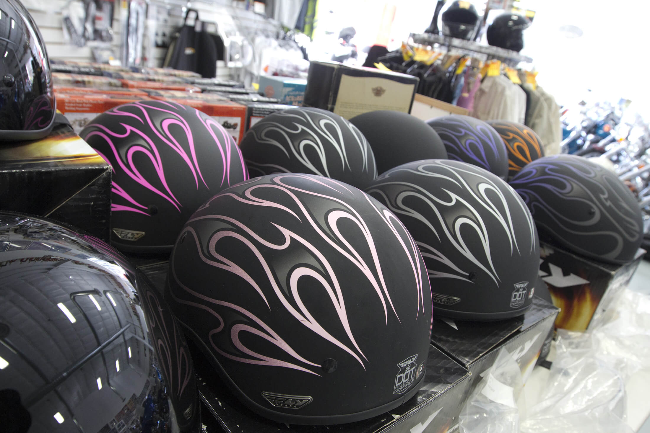 Motorcycle helmets in the shop