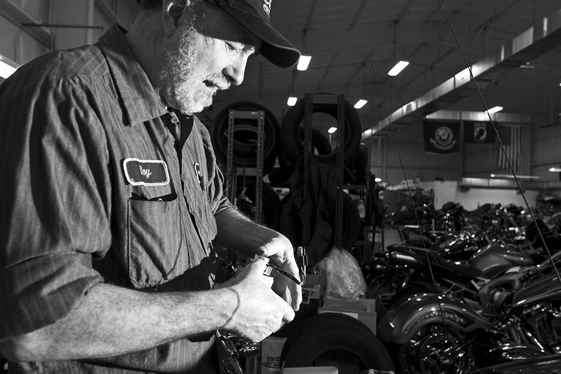 Roy Chamberlin in the shop working on a motorcycle